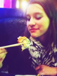 Reporter sampling the Crunchy Roll at Sakura