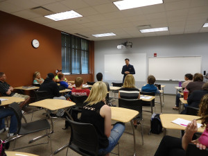 Conductor Ryan Haskins speaking to Music in Western Culture students at the College Center